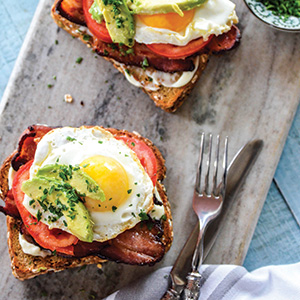 BACON, EGG, TOMATO, AND AVOCADO ON WHOLE-GRAIN TOAST
